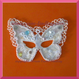 mardi-gras-white-mask-0n-orange-275
