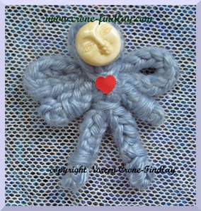 spool-knitted-tiny-angel-face-button-1000