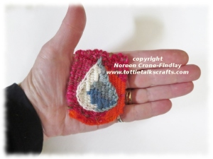Tiny Tapestry Diary of a prayer for rain  woven on the Thumbelina loom.