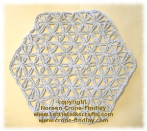 Flower of Life pattern woven on the hexagon loom by Noreen Crone-Findlay